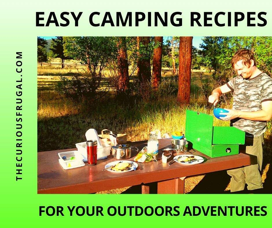 Camping recipes - Man cooking outside at a campsite with a picnic table with food on it