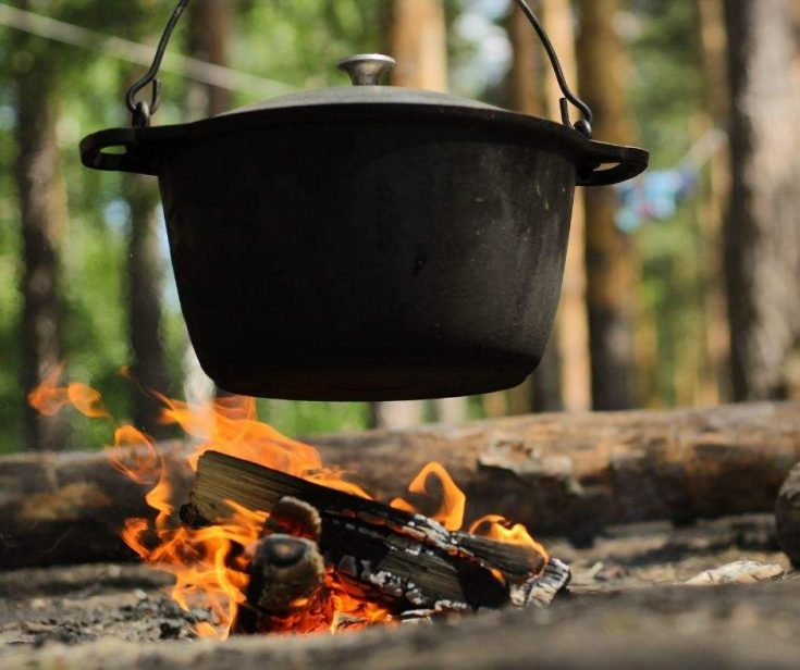 Camping recipes - cast iron dutch oven cooking over campfire