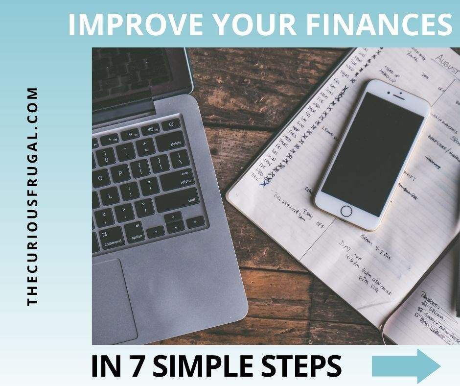 Improve your finances in 7 simple steps (laptop with cell phone and notebook with budget notes in it)