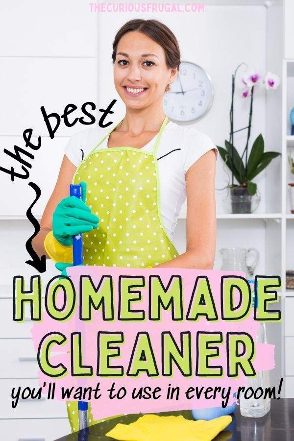 The best homemade cleaner you'll want to use in every room (woman smiling holding a mop with all-purpose cleaner)