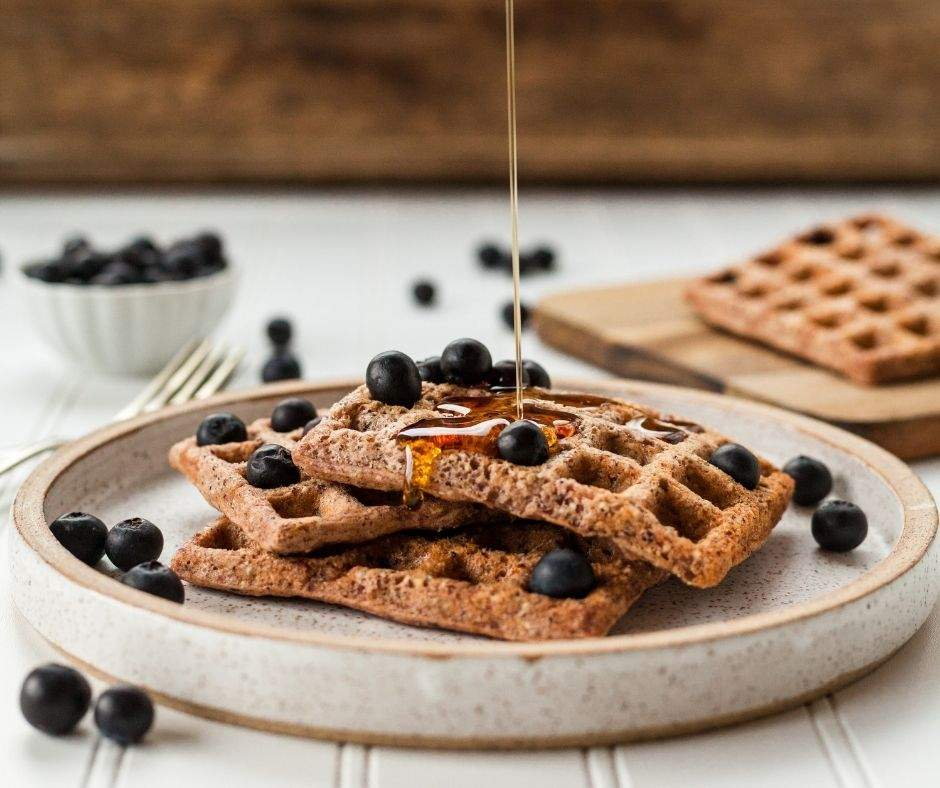 Pumpkin waffles with blueberries and syrup